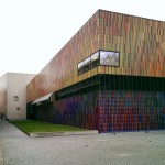 The striking facade features 36,000 ceramic rods in 23 different colours.