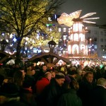 Crowds of tourists and locals gather in the markets for a glühwein and a catch up.