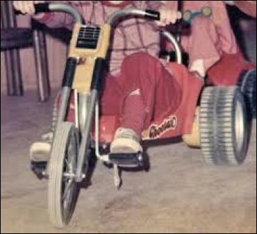 Brother on big wheels