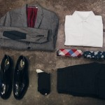 Johnston & Murphy Georgetown II Cap Toe shoe-black, Happy Socks-Kurbits, Ben Sherman Herringbone Blazer-Grey, Scotch & Soda Acid Rock Wool Pants-Grey, Ministry of Supply Appolo Shirt-White, Penguin Big Check and Floral Tie.
